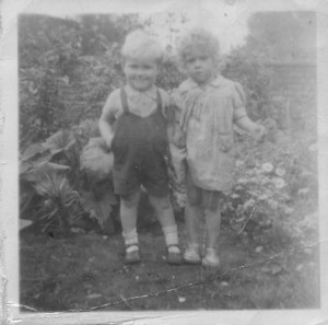 Brother Paul and neighbour in Grandma Beattie's house, 1948