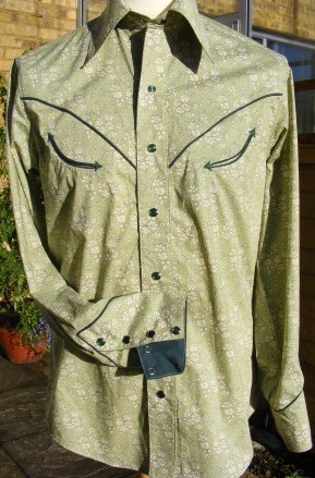 Custom-made shirt in Liberty 'Capel' with dark green piping, arrowheads and snaps